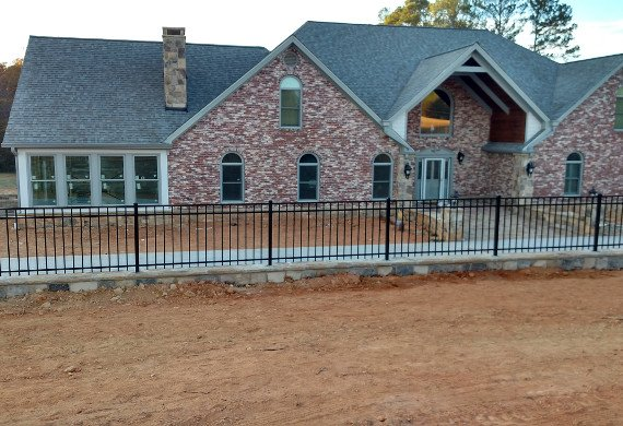 Aluminum fence on new construction house