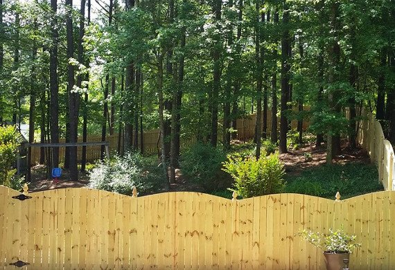 wooden fence with decorative top