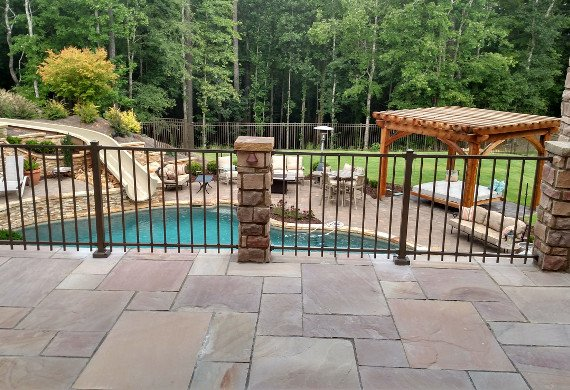 Patio railing with stonework and pool