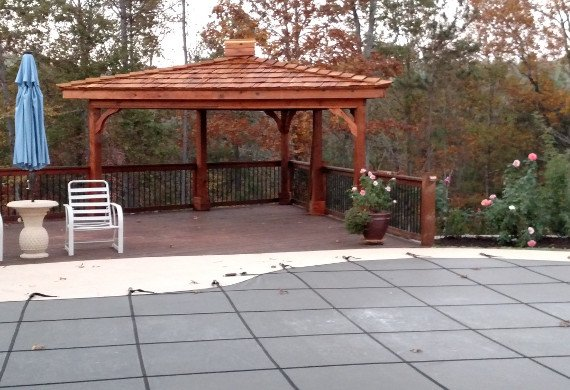 Patio railing with gazebo and pool